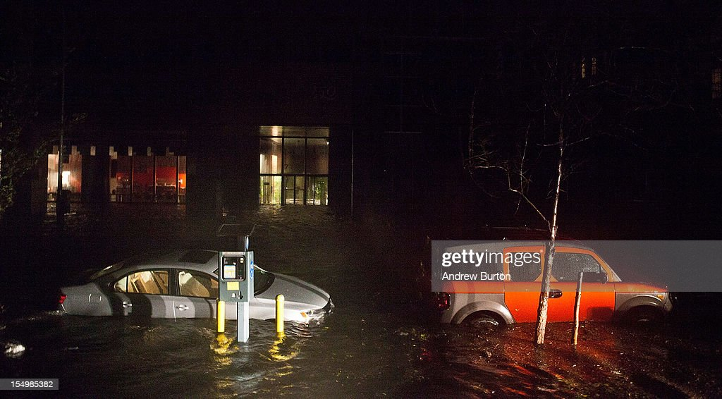 Flooded cars, caused by Hurricane Sandy, are seen on October 29, 2012, in the Financial District of New York, United States. Hurricane Sandy, which threatens 50 million people in the eastern third of the U.S., is expected to bring days of rain, high winds and possibly heavy snow. New York Governor Andrew Cuomo announced the closure of all New York City will bus, subway and commuter rail service as of Sunday evening
