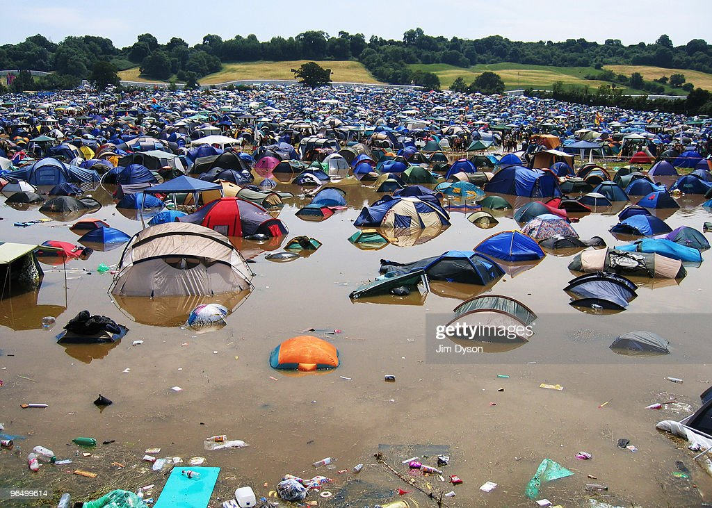 A flooded field is seen after a thunderous night of heavy rain during the first day of the Glastonbury Music Festival held at Worthy Farm on June 24, 2005 in Glastonbury, England.