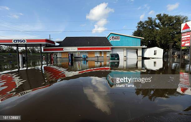 A flooded gas station sits in Hurricane Isaac's flood waters on September 1 2012 in Braithwaite Louisiana Louisiana residents continue to cope with...