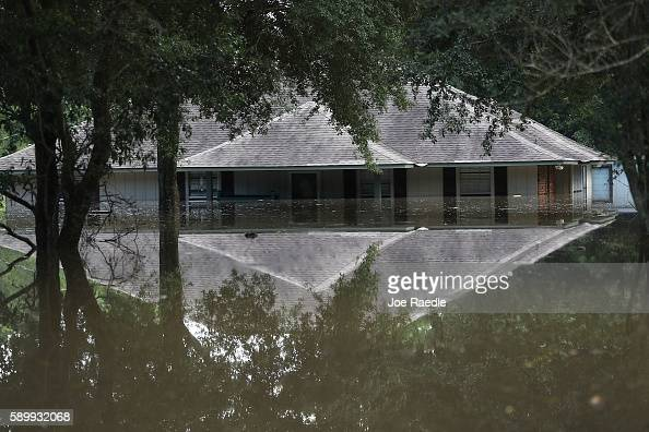 A flooded home is seen on August 15 2016 in Baton Rouge Louisiana Recordbreaking rains pelted Louisiana over the weekend leaving the city with...