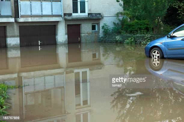 Flooded house and car