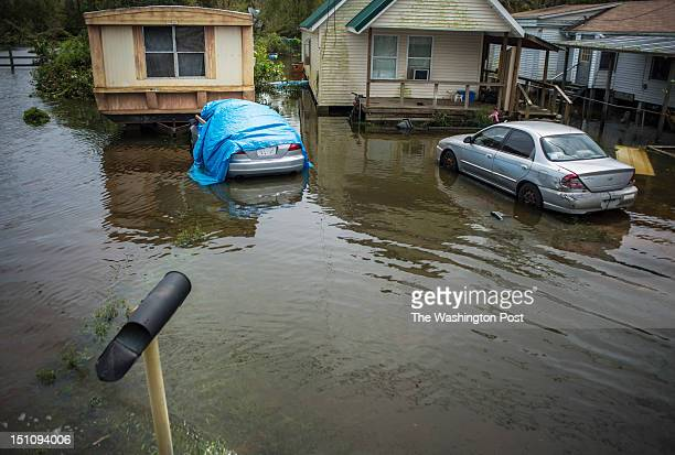 Flooded neighborhoods are passed as Republican GOP candidate for President Governor Mitt Romney Louisiana Governor Bobby Jindal and Ann Romney are...