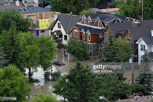 A flooded neighbourhood beside the flooded Bow River in Calgary Alberta Canada June 22 2013 Water levels have dropped slightly today AFP PHOTO/DAVE...