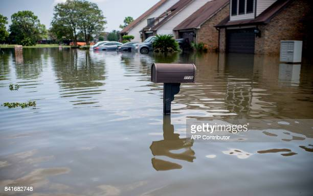 A flooded Regency Drive is seen in Port Arthur Texas on September 1 2017 Houston was limping back to life on Friday one week after Hurricane Harvey...