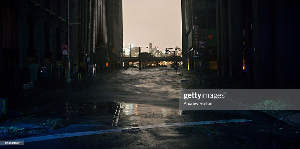 A flooded street, caused by Hurricane Sandy, is seen on October 29, 2012, in the Financial District of New York, United States. Hurricane Sandy, which threatens 50 million people in the eastern third of the U.S., is expected to bring days of rain, high winds and possibly heavy snow. New York Governor Andrew Cuomo announced the closure of all New York City will bus, subway and commuter rail service as of Sunday evening.