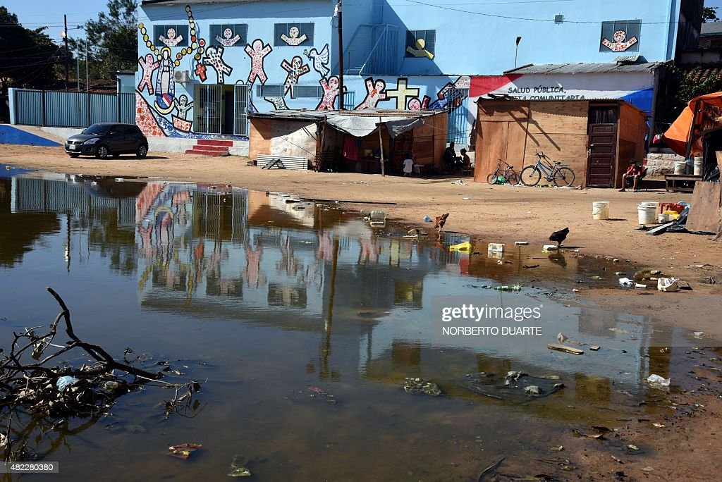A flooded street in the Banado Norte neighborhood in Asuncion on July 28 2015 The unusual flooding of the Paraguay river has left 37000 refugees so...