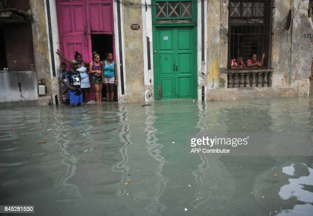 A flooded streets in Havana on September 10 2017 Deadly Hurricane Irma battered central Cuba on Saturday knocking down power lines uprooting trees...
