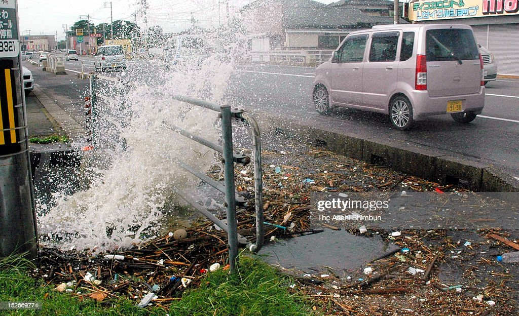 Flooded water splashes to the road as the high tide triggered by Typhoon Sanba on September 17, 2012 in Ube, Yanaguchi, Japan.