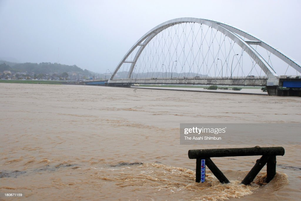 Flooded Yura River is seen triggered by typhoon Man-Yi approaching on September 16, 2013 in Fukuchiyama, Kyoto, Japan. The storm hit land near Toyohashi, Aichi Prefecture, before 8 a.m. and moved along Honshu throughout the day, damaging buildings, disrupting transportation and causing blackouts, three killed and five missing.