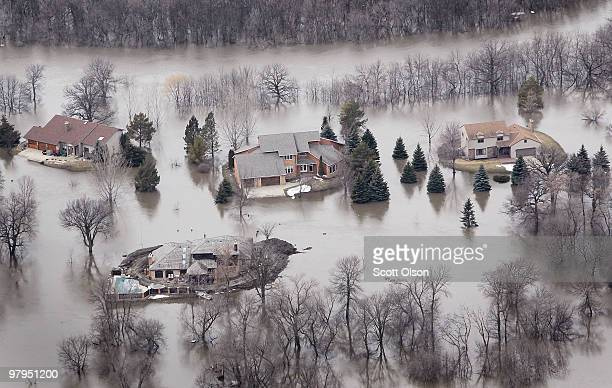 Flooding from the Red River inundates a neighborhood March 22 2010 near Fargo North Dakota Residents of Fargo neighboring Moorhead Minnesota and the...