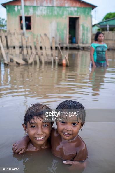 2015 flooding in Brazilian Amazon children play in the dirty waters of Acre river at Taquari district Rio Branco city Acre State Floods have been...