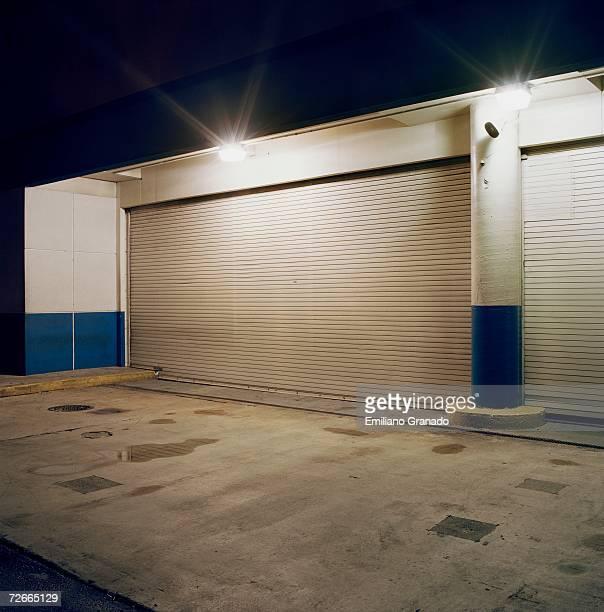 Floodlights above rolling garage doors at loading dock