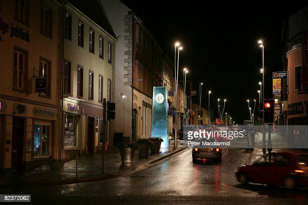 Floodlights illuminate a glass obelisk erected in memory of the Omagh bombing victims August 15 2008 in Omagh Northern Ireland Twentynine people and...