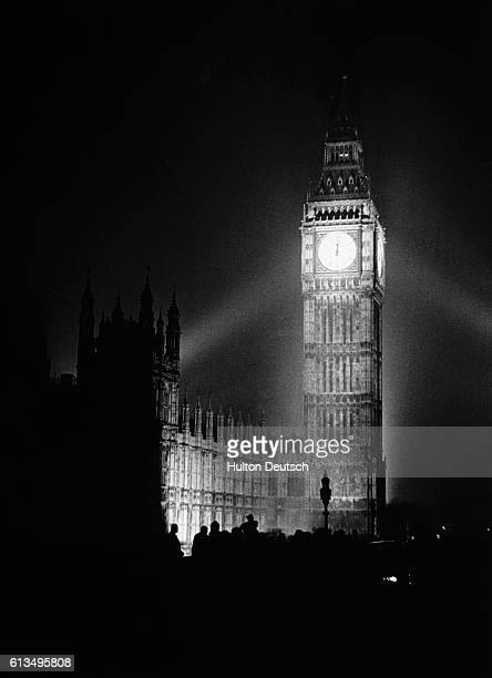 Floodlights illuminate the clock tower at Britain's Houses of Parliament at 1201 am on VE Day May 8 1945 The lights which would have been a beacon to...