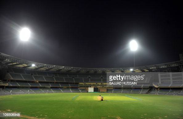 Floodlights shine down upon the pitch of the Wankhede Stadium in Mumbai on February 20 2011 The 2011 Cricket World Cup takes place in India Sri Lanka...