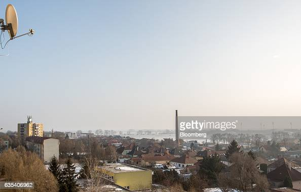 Floodlights surround the stadium of Slovakian football club FC STK Samorin on the horizon in a view of the town from players accommodation in Samorin...