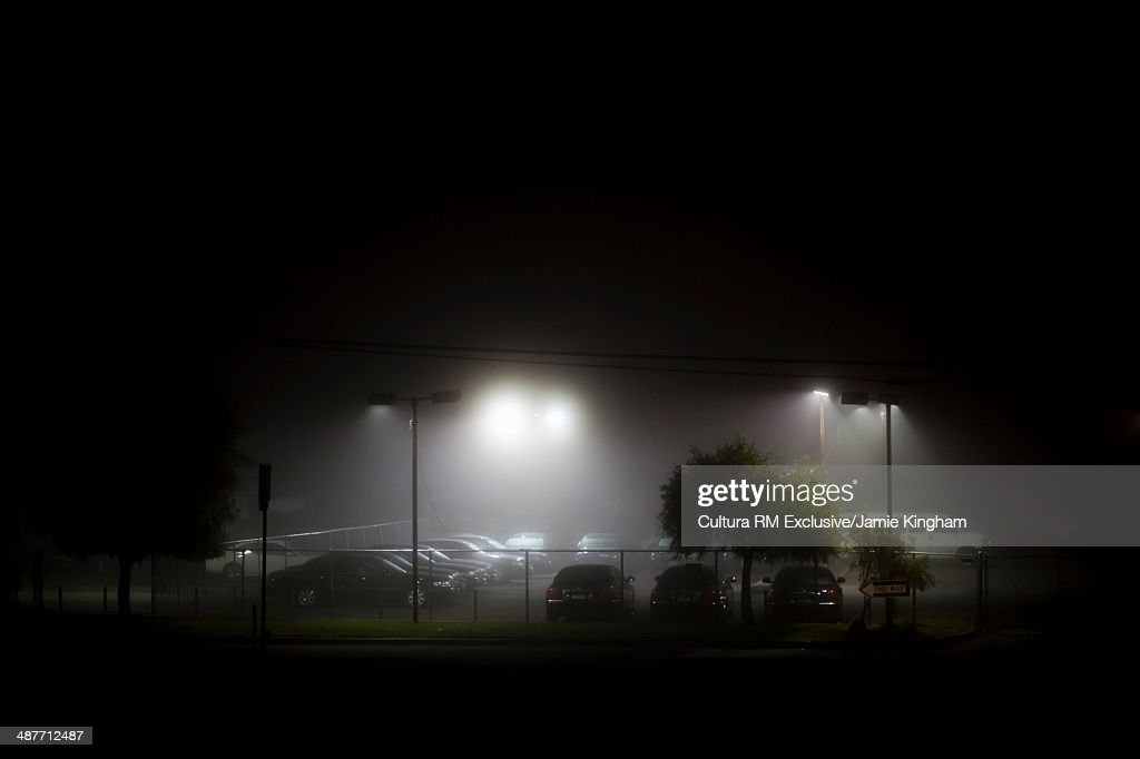 Floodlit  parking lot at night : Stock Photo