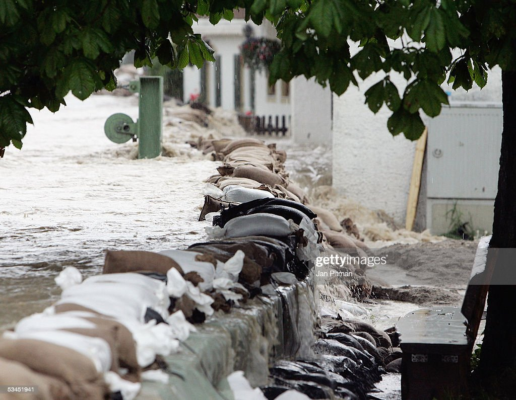 Floodwater breaks over sandbags defences on August 23, 2005 in Eschenlohe, Germany. Heavy rainfall and floods in both Austria and Switzerland caused many of the rivers in southern Germany to flood. Half of Eschenlohe town has been evacuated and streets in the whole area are closed to traffic.