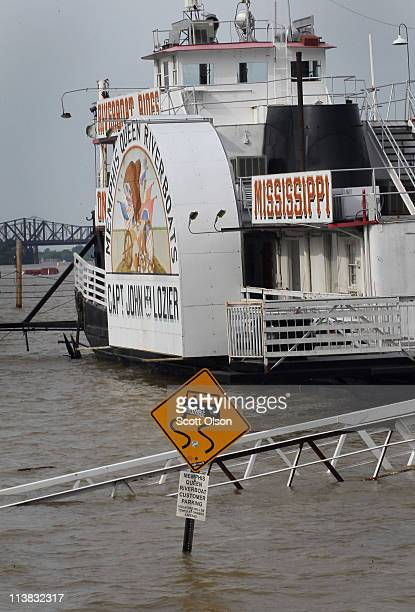 Floodwater covers the parking area and walkway for the Memphis Queen riverboat May 7 2011 in Memphis Tennessee Heavy rains have left the ground...