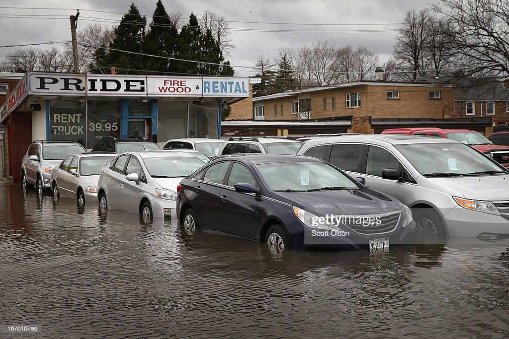 Floodwater engulfs a car lot April 19, 2013 in Des Plaines, Illinois. The suburban Chicago town is battling floodwater from the Des Plaines River which is expected to crest at a record 11 feet later today. Record-setting rains and rising rivers have caused wide-spread flooding in many Illinois communities.