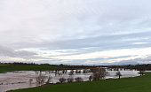 Floodwater from the river Petteril covers meadows on the outskirts of Carlisle on December 6 2015 One man was killed yesterday as Storm Desmond...