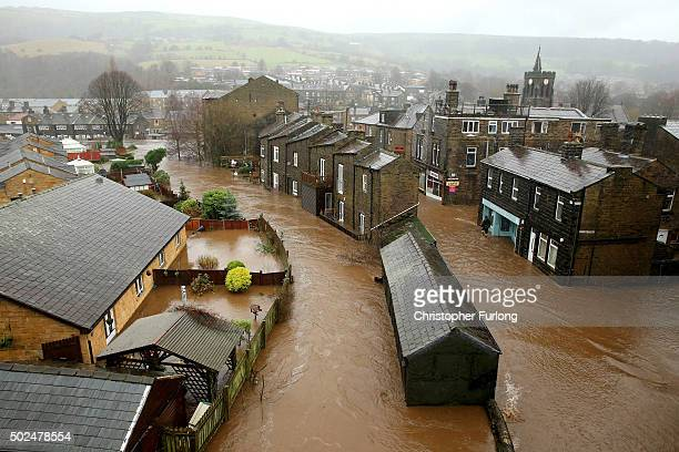 Floodwater rises as the River Calder bursts its bank's in the Calder Valley town of Mytholmroyd on December 26 2015 in Mytholmroyd England There are...