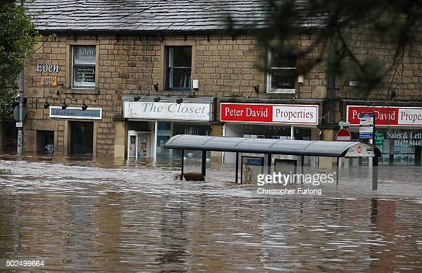 Floodwaters continue to rise after rivers burst their banks on December 26 2015 in Hebden Bridge England There are more than 200 flood warnings...