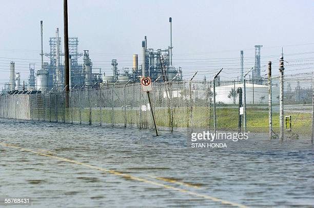 Floodwaters cover an access road to oil refineries 25 September 2005 in Port Arthur Texas in the aftermath of Hurricane Rita The US oil industry...