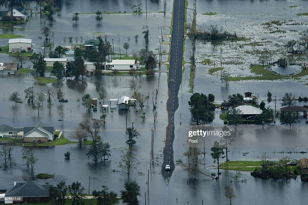 Floodwaters from Hurricane Ike surround houses September 14 2008 near Winnie Texas Hurricane Ike made landfall yesterday morning at Galveston causing...
