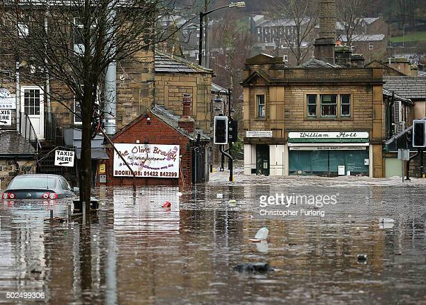 Floodwaters surge around the William Holt store as rivers burst their banks on December 26 2015 in Hebden Bridge England There are more than 200...