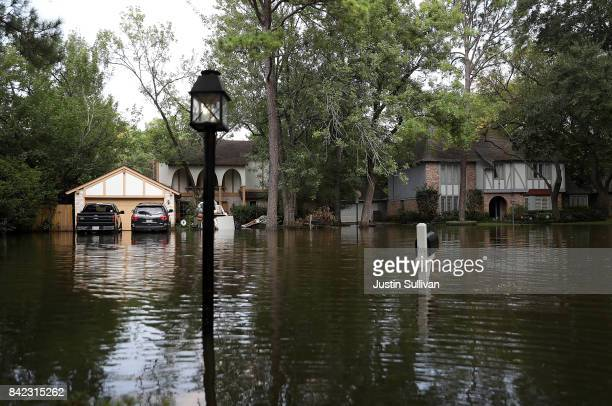 Floodwaters surround homes on September 3 2017 in Houston Texas A week after Hurricane Harvey hit Southern Texas residents are beginning the long...