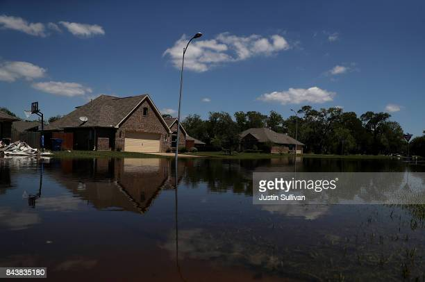 Floodwaters surround homes on September 7 2017 in Richwood Texas Over a week after Hurricane Harvey hit Southern Texas residents are beginning the...