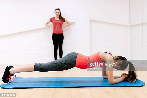 Floor exercises in an exercise studio