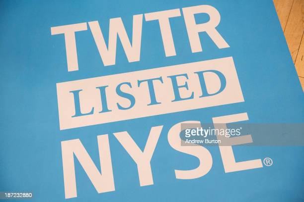 A floor mat bearing the logo of Twitter and the symbol on which Twitter's stock will traded is seen on the floor of the New York Stock Exchange on...