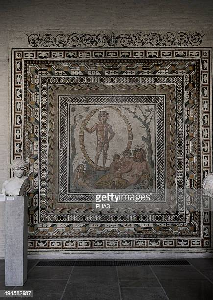 Floor mosaic About 200 AD From a Roman villa near Sentium in the Marches Aion god of Eternity surrounded by a zodiac wheel the seated earth mother...