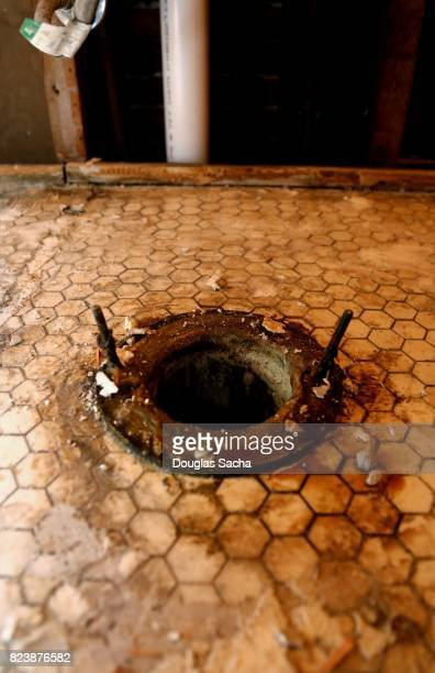 Floor opening for a sewer drain on a toilet
