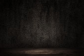 Dark room with wooden floor concrete wall background