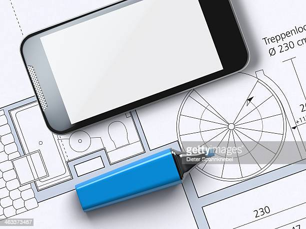 Floor plan with highlighter and smartphone