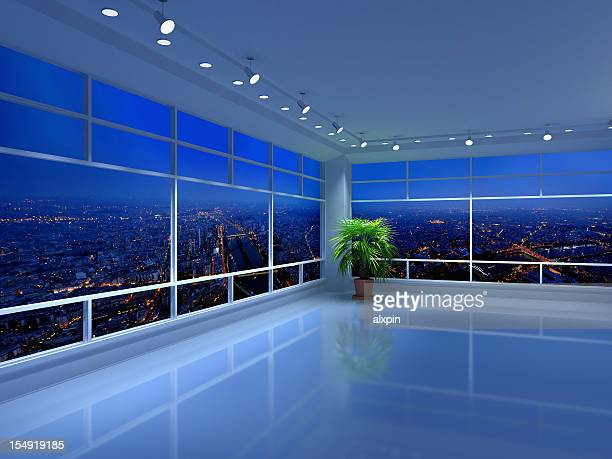 Floor to ceiling city views from an all-white penthouse