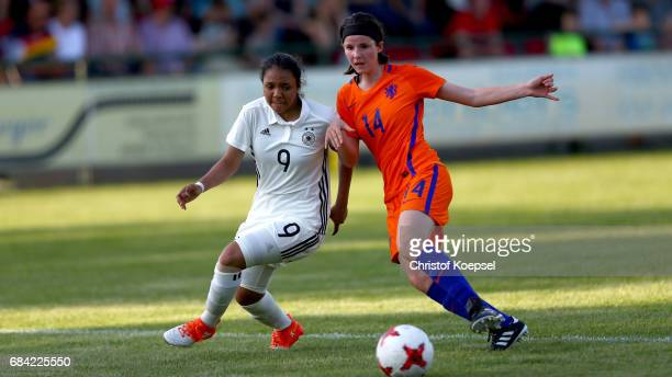 Floor van Loon of the Netherlands challenges Gia Corley of Germany during the U15 girl's international friendly match between Germany and Netherlands...