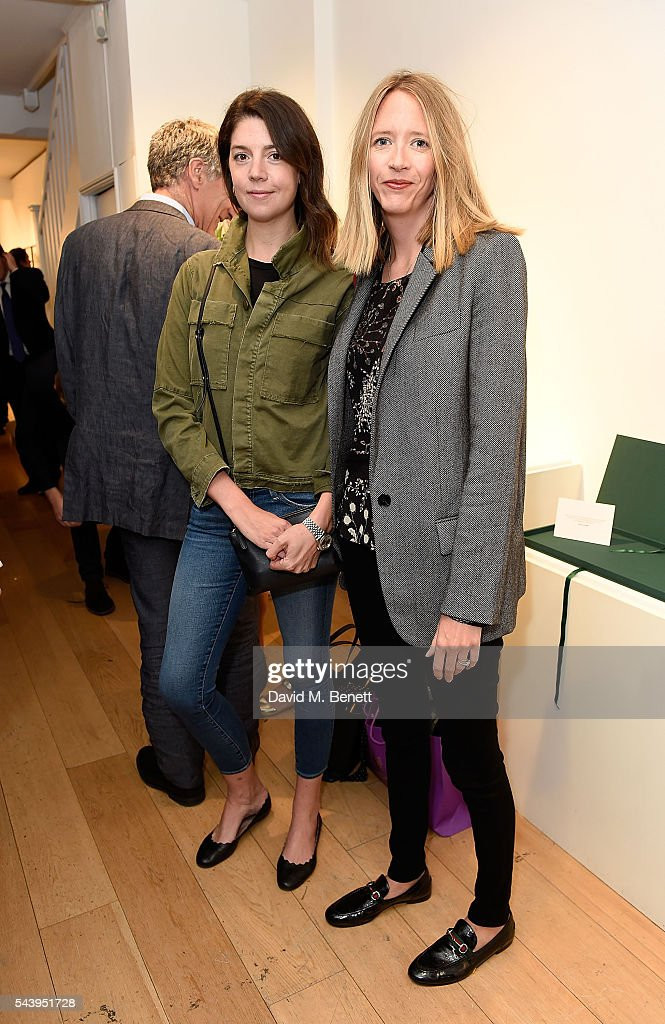 Flora Goodwin (R) and guest attend the exhibition launch party of 'The Zero Hour Panoramas' by Jolyon Fenwick. The exhibition consists of 14 photographic panoramas showcasing, '100 Years on: Views From The Parapet of the Somme', at Sladmore Contemporary on June 30, 2016 in London, England.