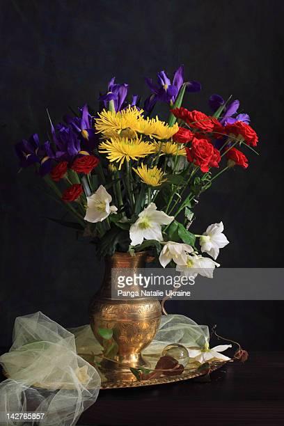 Floral arrangement on wooden table