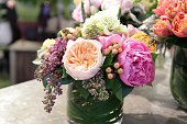 Spring time bouquet of cut flowers in vase.