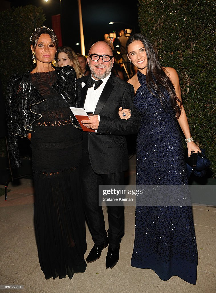 Floral designer Eric Buterbaugh (C), actress Demi Moore (R) and guest (L) attend the Wallis Annenberg Center for the Performing Arts Inaugural Gala presented by Salvatore Ferragamo at the Wallis Annenberg Center for the Performing Arts on October 17, 2013 in Beverly Hills, California.