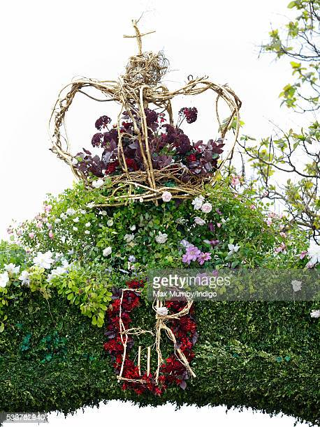 A floral display in the shape of a crown and ER Cypher at the RHS Chelsea Flower Show press day at the Royal Hospital Chelsea on May 23 2016 in...