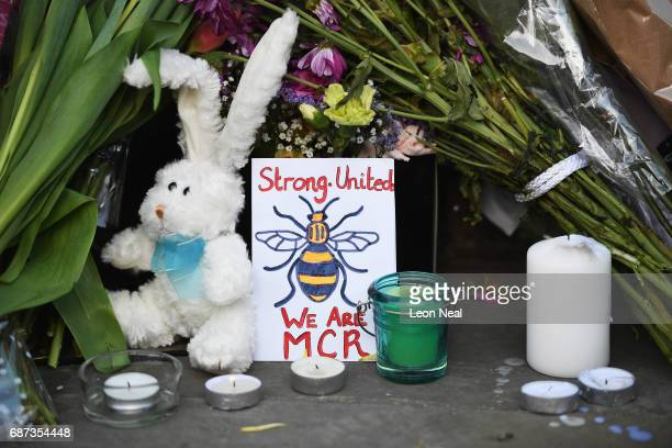 A floral tribute is laid during a candlelit vigil to honour the victims of Monday evening's terror attack at Albert Square on May 23 2017 in...