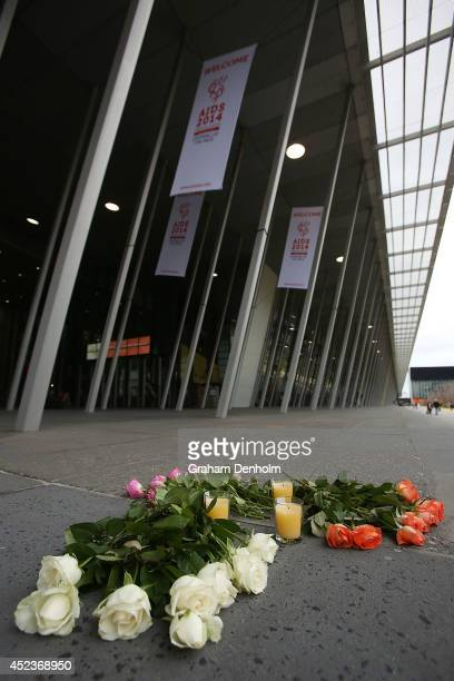 A floral tribute is seen on the steps of the Melbourne Convention and Exhibition Centre where the 20th International AIDS Conference is being held on...
