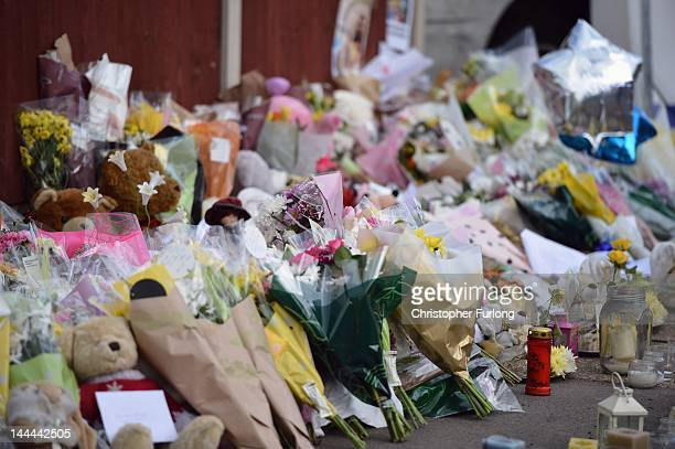 Floral tributes adorn the pavement outside a house in Allenton after a fire claimed the lives of six children on May 14 2012 in Derby England Duwayne...