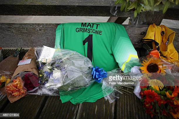 Floral tributes and a football shirt in memory of victim Matt Grimstone are placed on a bridge over the river Adur near where a Hawker Hunter fighter...