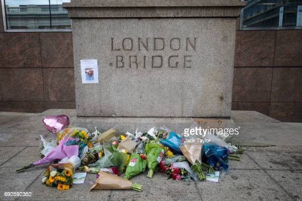 Floral tributes and a missing persons sign lay on London Bridge following the June 3rd terror attack on June 5 2017 in London England Seven people...